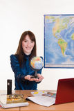 Young employee travel company with a globe in his hand Royalty Free Stock Photos