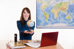 Young employee travel company stretches hands Globe Stock Photos