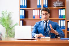 The young employee working in the office royalty free stock photos