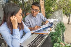 Young employees discuss about business report royalty free stock photos