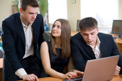 Young employees with the laptop Royalty Free Stock Photos
