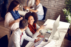 Young employees in office. Group of young employees in office talking and working royalty free stock images