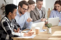 Young employees sitting at the desk in office at meeting stock photos