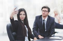 Young employees are taking selfies at their Desk. Photo with copy space Stock Photography