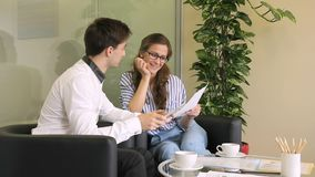 Young employees talk over cup of coffee in large company. stock video footage
