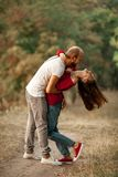 Young enamored couple embraces and laughs cheerfully on rest in. Young enamored couple have fun on rest in forest. They embrace and laugh cheerfully royalty free stock photography