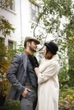 Young retro gangster couple hugging outdoors. Outdoors. Royalty Free Stock Photography