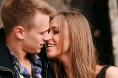 Young Enamoured Pair A Brick Wall Stock Photo
