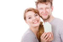 Young enamoured pair showing house symbol. Royalty Free Stock Images