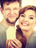 Young enamoured pair showing house symbol. Stock Image