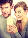Young enamoured pair showing house symbol. Royalty Free Stock Photography