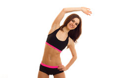 A young energetic fitness girl smiling and doing exercises is. Isolated on white background stock images