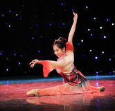 Young and energetic girl in a solo dance Stock Photography