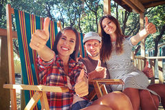 Young energetic group of people showing thumbs up Stock Image