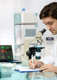 Young energetic male tech or scientist works in research facilit Royalty Free Stock Photography