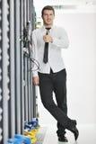 Young engeneer in datacenter server room Stock Photos