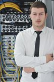 Young engeneer in datacenter server room Royalty Free Stock Image