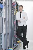 Young engeneer in datacenter server room Royalty Free Stock Photo