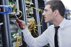 Young engeneer in datacenter server room Stock Images