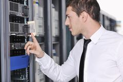 Young engeneer in datacenter server room Stock Image