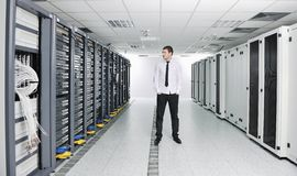 Young engeneer in datacenter server room Stock Images
