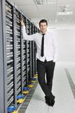 Young engeneer in datacenter server room Stock Photography