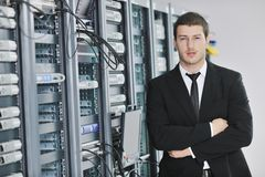 Young engeneer in datacenter server room Royalty Free Stock Photography