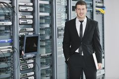 Young engeneer in datacenter server room Royalty Free Stock Images