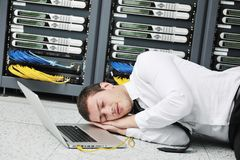 Young it engeneer in datacenter server room Stock Photography