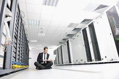 Young it engeneer in datacenter server room Stock Photos