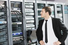 Young it engeneer in datacenter server room Stock Photos
