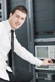 Young it engeneer in datacenter server room Stock Images