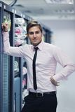 Young it engeneer in datacenter server room Royalty Free Stock Image