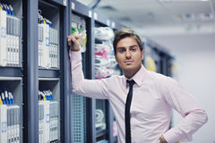Young it engeneer in datacenter server room Royalty Free Stock Images