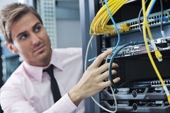 Young it engeneer in datacenter server room Stock Image