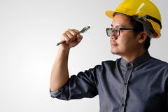 Young engineer is actively acting ready to work. A young engineer is actively acting ready to work on a white background Stock Photography