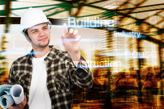 Young engineer,Architect,businessman pointing at building and construction concept Stock Image