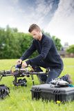 Young Engineer Assembling UAV stock images