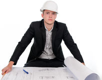 Young Engineer with Blueprint Looking at Camera Stock Image