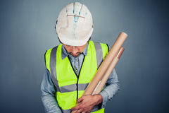 Young engineer with building plans Royalty Free Stock Photography
