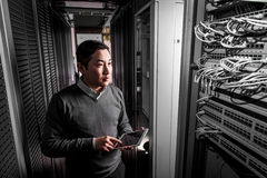 Young engineer businessman in server room Royalty Free Stock Photography