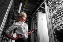 Young engineer businesswoman in network server room Stock Photos