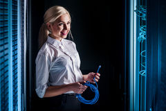 Young engineer businesswoman in network server room Royalty Free Stock Photos