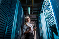 Young engineer businesswoman in network server room Stock Image