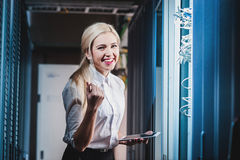 Young engineer businesswoman in network server room Royalty Free Stock Photo