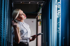 Young engineer businesswoman in network server room Royalty Free Stock Image