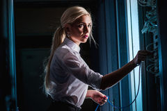Young engineer businesswoman in server room Royalty Free Stock Photo