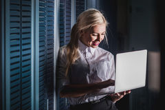 Young engineer businesswoman in server room Stock Images