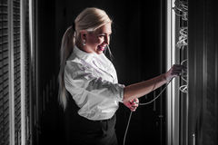 Young engineer businesswoman in server room Stock Photos