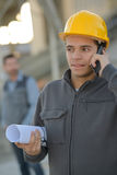 Young engineer on call Stock Images